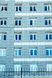 Windows on facade of a multi-storey building. Windows on the facade of a multi-storey building Royalty Free Stock Images
