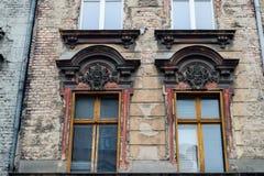 Windows and facade of old building. POLAND, POZNAN - 28 JUNE 2015: Windows and facade of old building Old Town Strzelecka Street Stock Photo