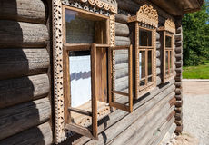 Windows on the facade of the wooden house Stock Image