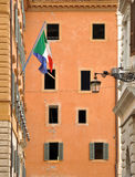 Windows and the flag of Italy Stock Photography