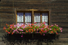 Windows and flower boxes. Mountain Royalty Free Stock Photography