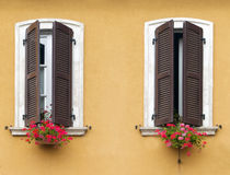 Windows with flowers in Italy Royalty Free Stock Images
