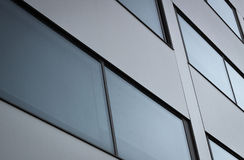 Windows. Four blue perpendicular windows in a building Royalty Free Stock Images