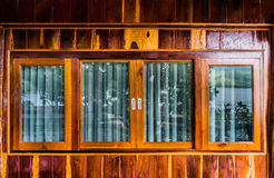 The windows. Four windows on house wood wall Stock Images