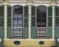 Windows in French Quarter Apartment. A tight view of windows on a home in the French Quarter of New Orleans in Louisiana Stock Photo