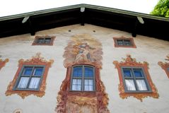 Windows and frescoes in Oberammergau in Germanya. Photo made in Oberammergau in Bavaria (Germany). The picture shows the facade of one of the typical houses of Royalty Free Stock Photo