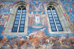 Windows and frescoes in a painted monastery chuch, Bukovina, Mol Stock Image