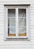 Windows with glazing bars. Close-up of closed windows with glazing bars in a gray Swedish older wooden building Stock Photos