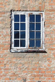 Windows with glazing bars. An old windows with glazing bars in a red brick wall Royalty Free Stock Photography