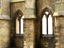 Windows of gothic cathedral. Two windows of the ruin of an old gothic cathedral. The view out of the windows is left white royalty free stock images