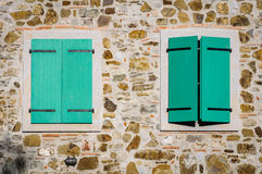 Windows with green shutter Royalty Free Stock Images