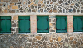 Windows with green shutters Stock Images