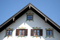 Windows with green shutters and curtains white in Oberammergau in Germany. Photo made in Oberammergau in Bavaria (Germany). The picture shows the upper part of Stock Images