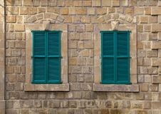 Windows with green shutters on an old house royalty free stock photos