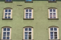 Windows in green wall Royalty Free Stock Photography