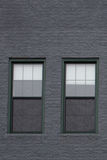 Windows in Grey Brick Wall Stockbilder