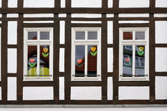 Windows of half-timber house in Hameln, Germany. Stock Images