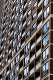 Windows in high-rise apartment block Stock Photography