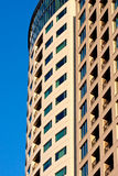 Windows in a High Rise Condo Building on Blue. A modern high rise condo building with windows and balconies on a blue sky Stock Photography