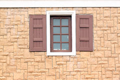 Windows of homes with brick wall surround. Stock Image