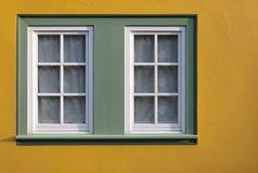 Windows of the house. On the yellow wall Stock Photo