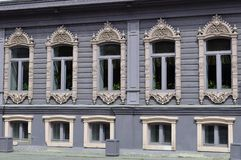 Windows of the house of merchants Chiralov. Architectural monume Royalty Free Stock Photography