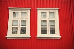Windows in house in reykjavik, iceland. Building facade with red wall and white window frames. Architecture structure. And design stock photos