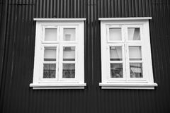 Windows in house in reykjavik, iceland. Building facade with red wall and white window frames. Architecture structure. And design stock photography