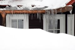 Windows and icicles Royalty Free Stock Photos