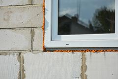 Windows installation and insulation in new house construction bu. Windows installation, repair and insulation in new house construction building Stock Photography