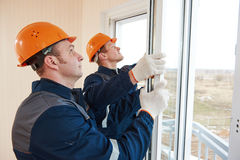 Windows installation workers. Two windows installation workers installing double-glass pane Royalty Free Stock Photos