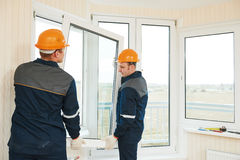 Windows installation workers. Two windows installation workers installing double-glass pane Stock Images