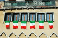 Windows with italian flags,old Venice Stock Photos