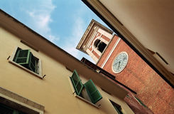 Windows in Italy. And a tower with a clock Stock Photos