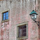 Windows and lamppost in an old facade. Almeida stock photography