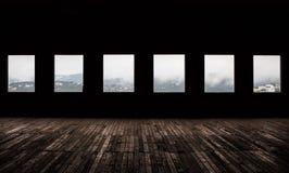 Windows. Large dark room with bright light coming in through windows Stock Photos