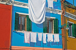 Windows with laundry Royalty Free Stock Photography
