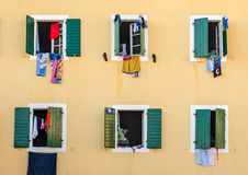 Windows with laundry Royalty Free Stock Image