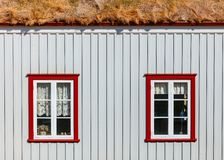 Windows of a little house royalty free stock image