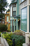 Victorian style homes at Roche Harbor on San Juan Island. Windows of luxury Victorian style homes at Roche Harbor on San Juan Island reflect boats in its harbor Stock Photos