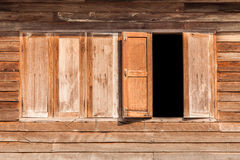 Windows made of old wood on wooden wall Royalty Free Stock Images