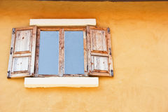 Windows made ​​of wood, the yellow background Stock Image