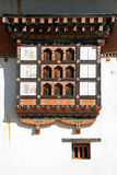 Windows on the main facade of the Gangtey Gompa in Gangtey, Bhutan Stock Image
