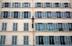 Windows med stänger med fönsterluckor Royaltyfria Bilder