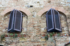 Windows on medieval brick wall Stock Images