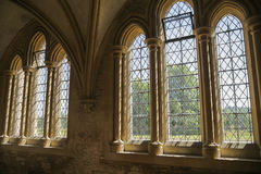 Windows in medieval cloister royalty free stock images
