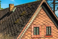 Windows minimalism background. Old house top with traditional roof and two triangle little windows Stock Photo