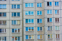 Windows mirroring home building in block of flats Stock Images