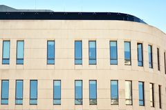 The windows of a modern building for offices. Business buildings architecture. royalty free stock image