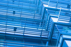 Windows of modern building toned in blue color stock images